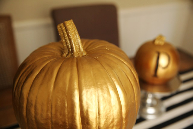 A decorated pumpkin with a glitter stem