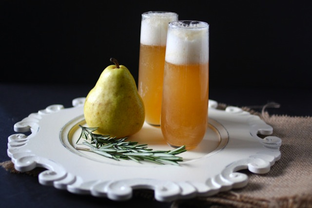 Two Thanksgiving cocktails next to a pear