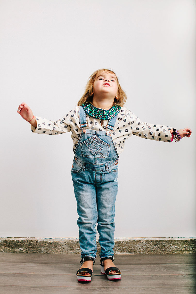 A girl in dungarees