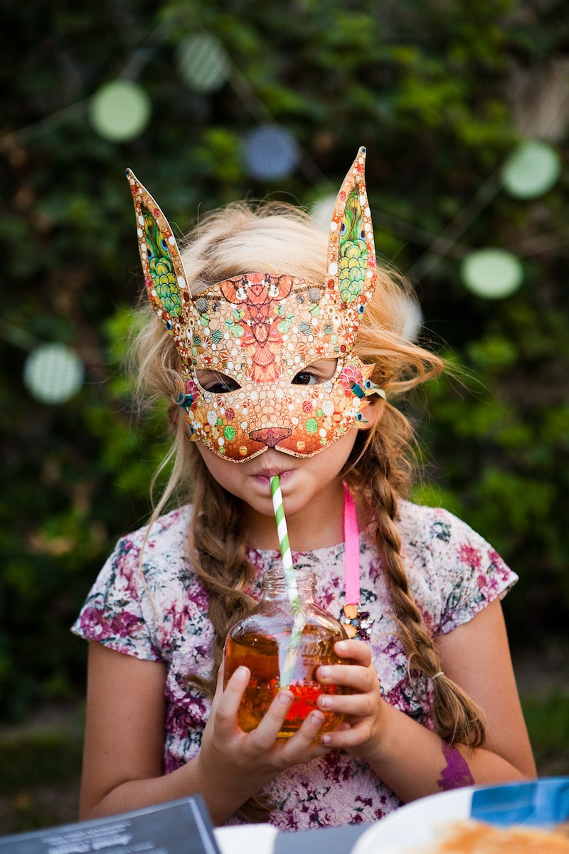 A child in a rabbit mask