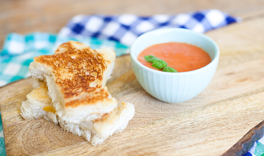 Two Grilled Cheeses with a bowl of Tomato Soup