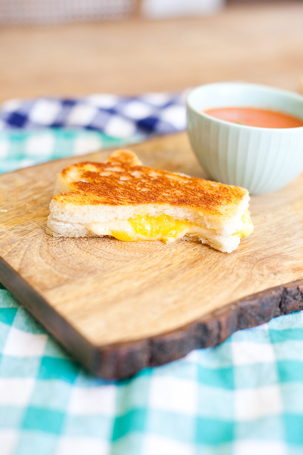 Grilled Cheese and Tomato Soup on a wooden board
