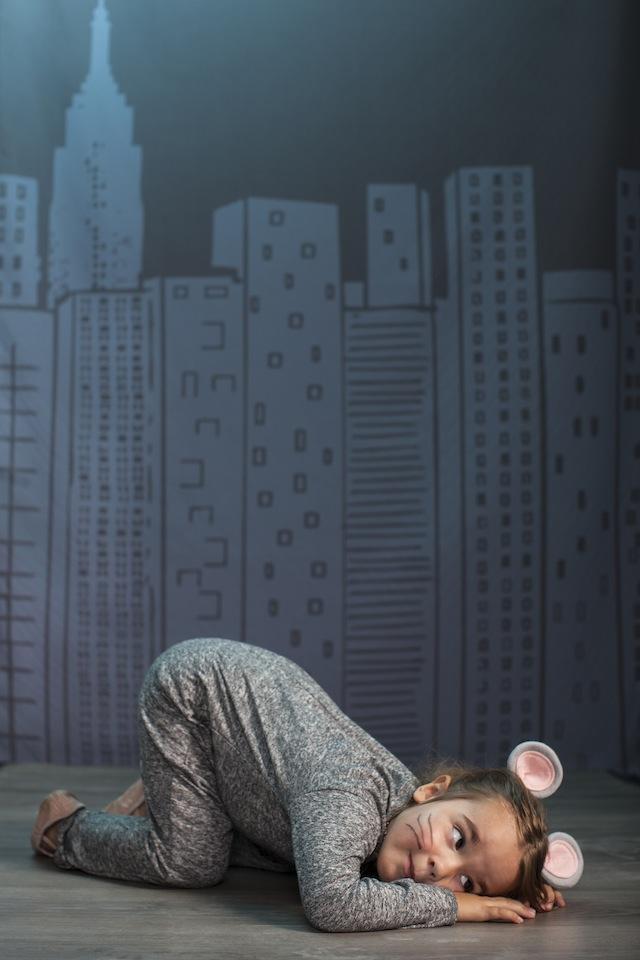 A little girl wearing mouse ears