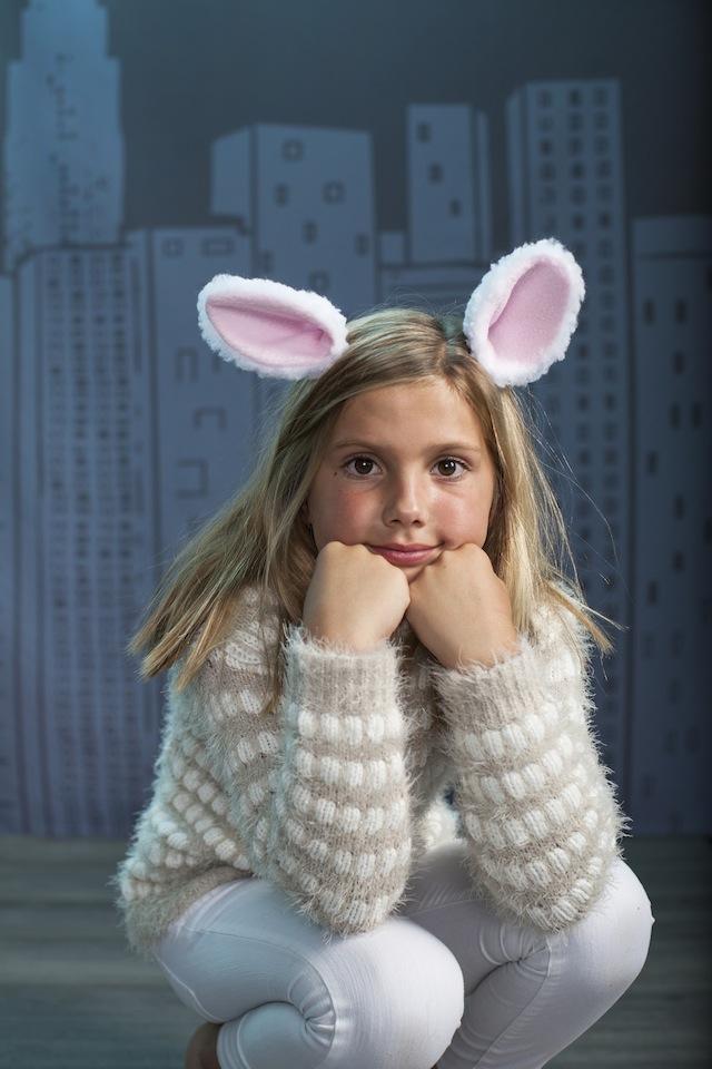 A girl wearing rabbit ears