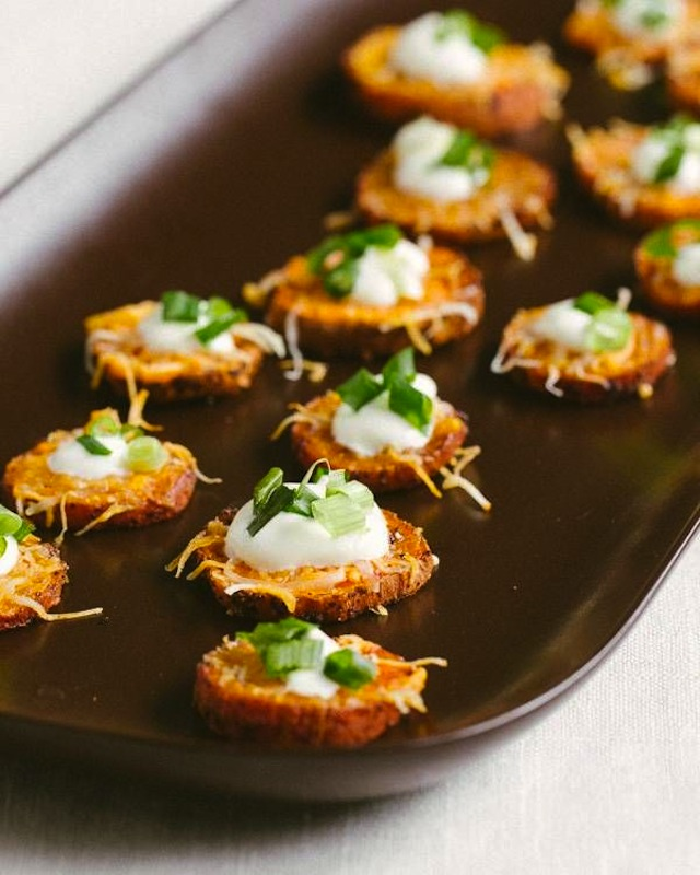 Sweet potato appetizers on a black plate