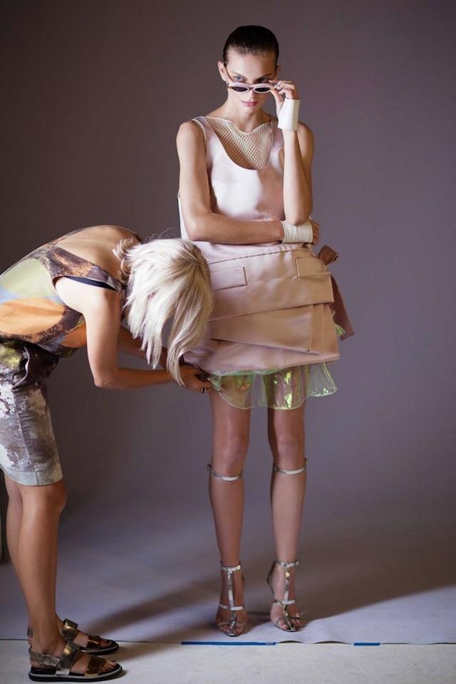 A fashion stylist working with a model