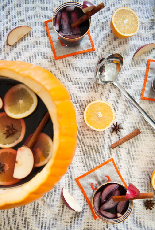 Fall sangria in glasses and in a pumpkin