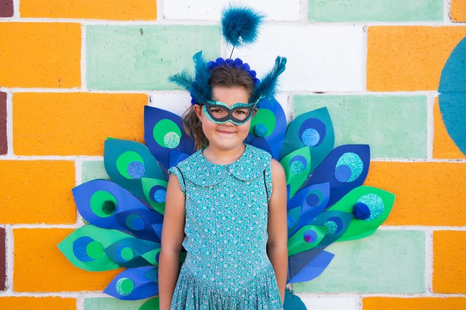 A little girl in a Peacock Halloween Costume