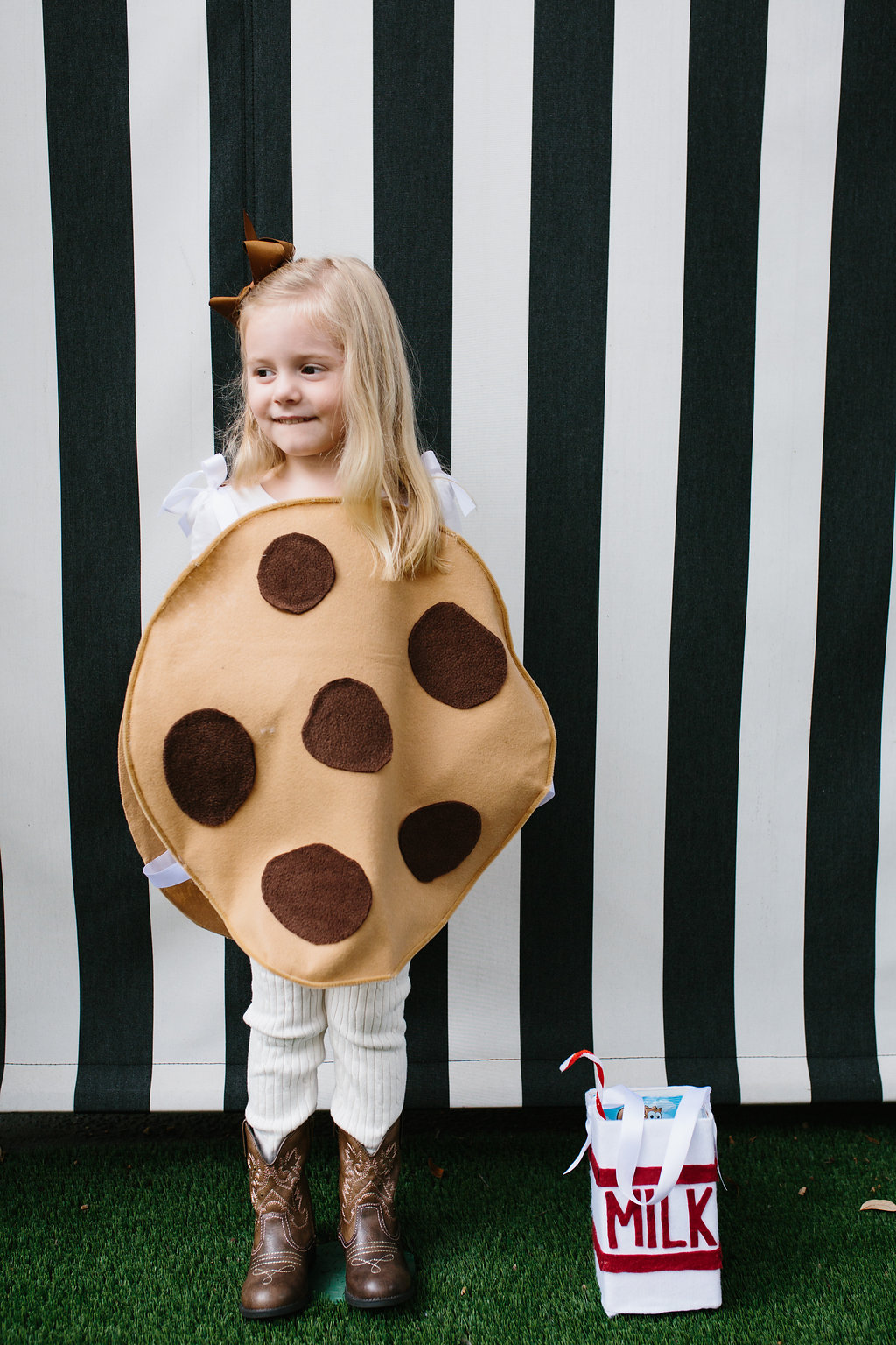 A young girl wearing a Chocolate Chip Cookie Costume