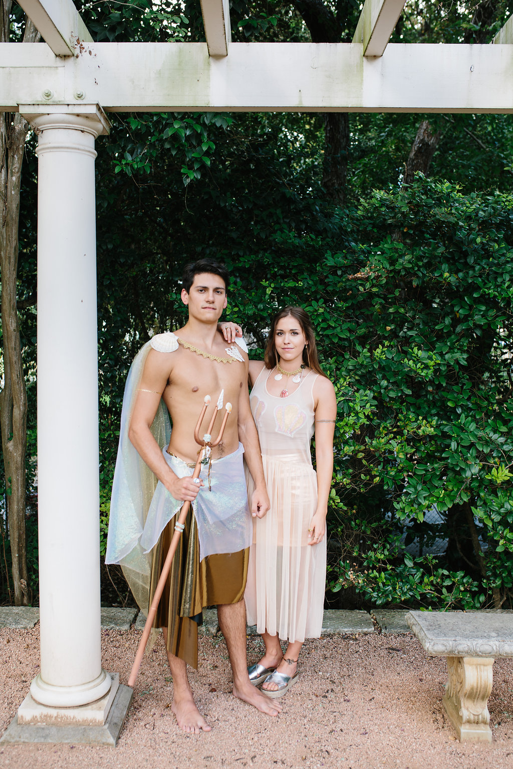 A couple wearing a mermaid and merman costume