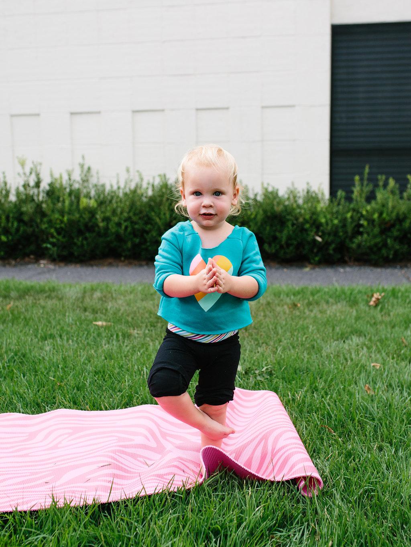 A toddler in a yogi costume