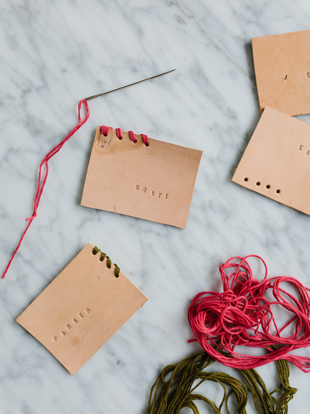 DIY leather place cards on a marble work surface
