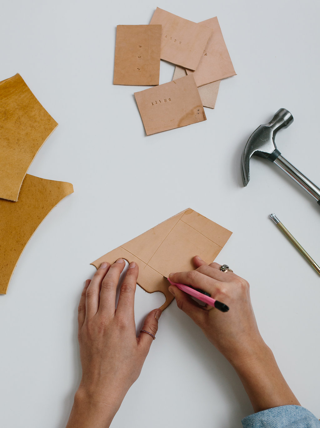Cutting out the DIY leather place cards