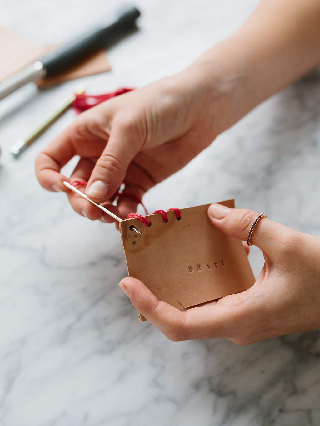 Sewing the DIY leather place cards
