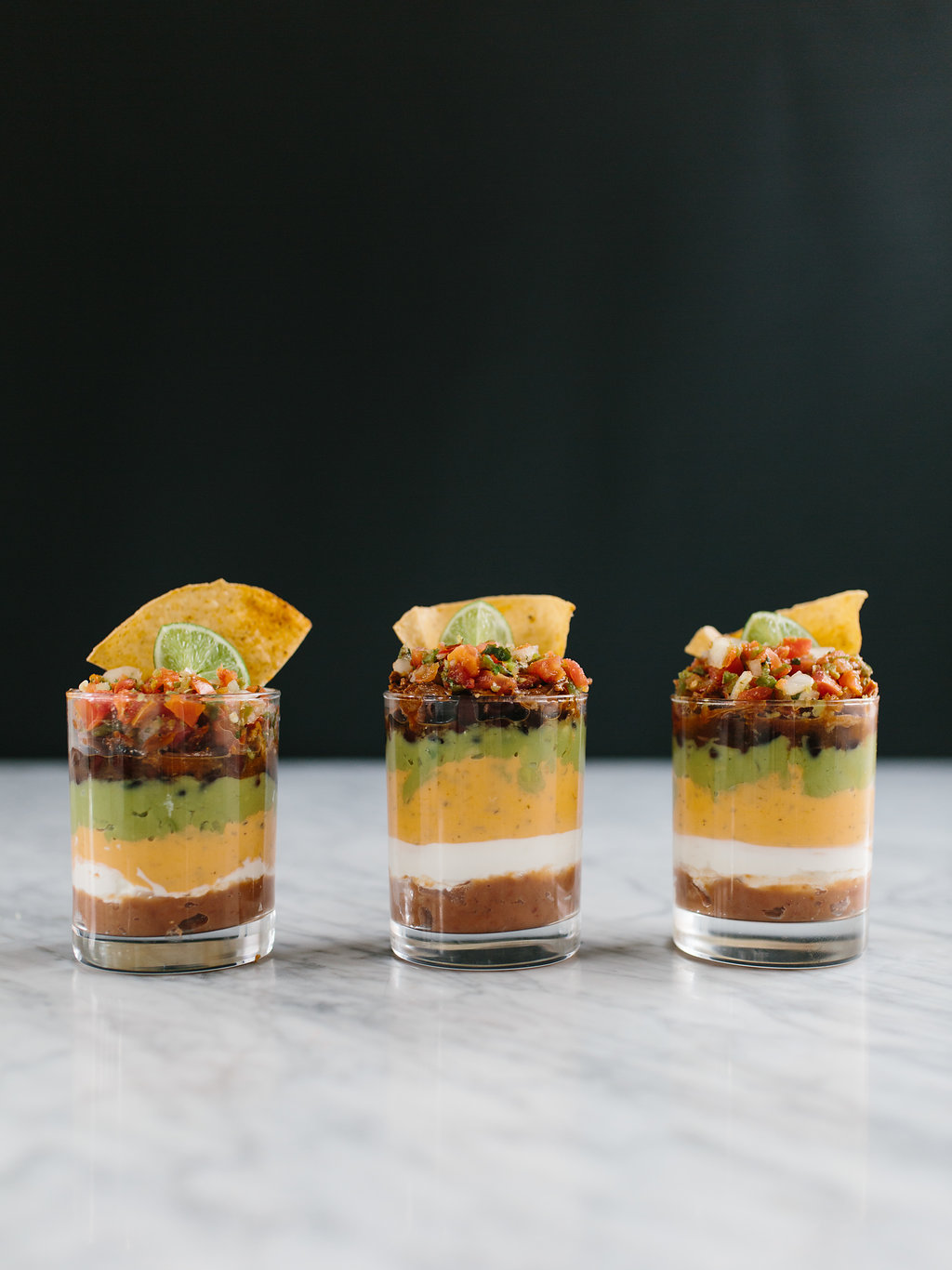 seven layer dip in three cups