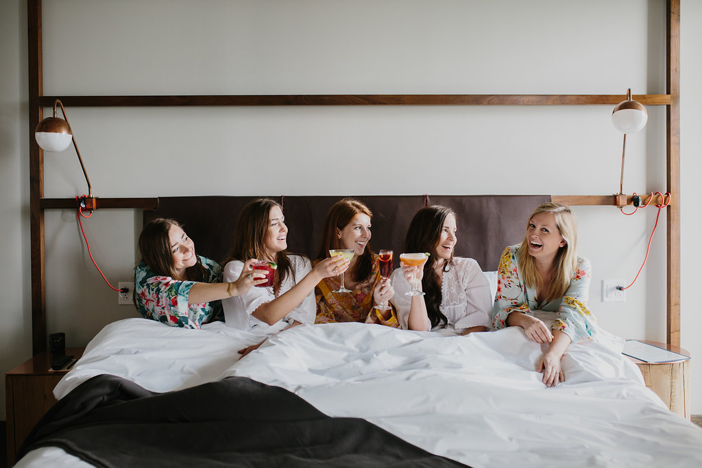 Women drinking coffee in bed together