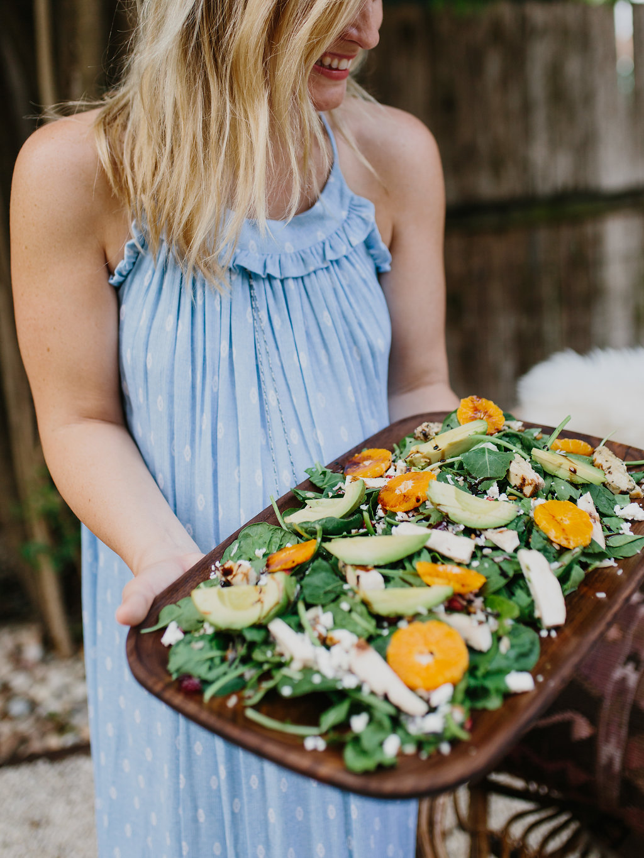 holding citrus salad