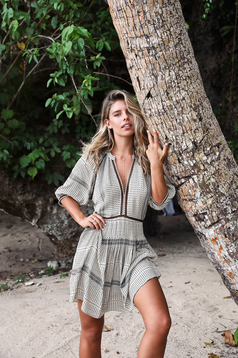 Model wearing a cover up dress on the beach