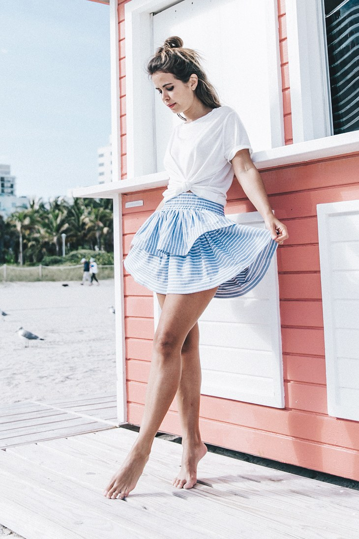 Model in a blue mini skirt cover up