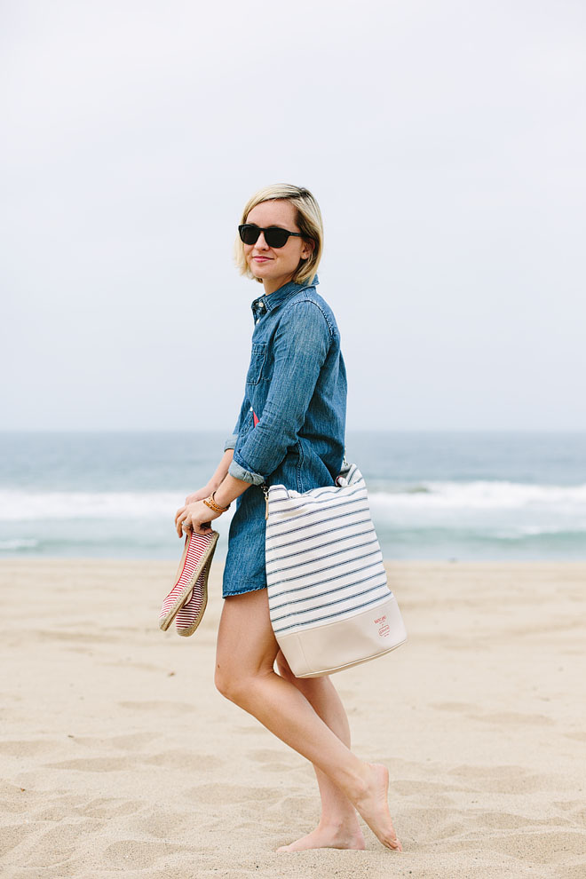 Model in a denim shirt cover up on the beach