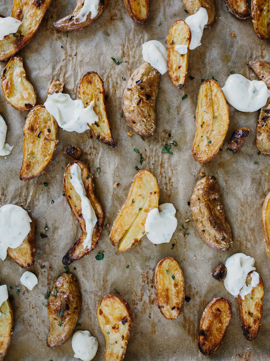 Roasted Fingerling Potatoes on parchment with aioli