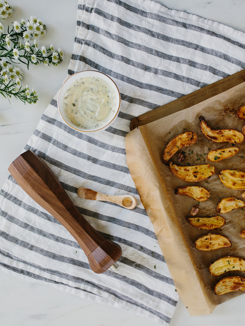 Roasted Fingerling Potatoes in a baking tray next to a dip