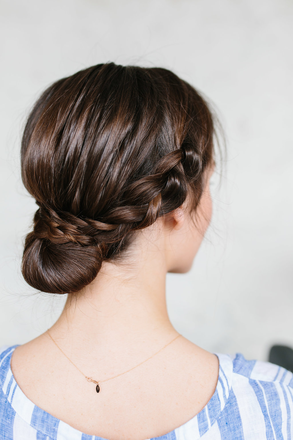 A woman wearing a braided bun