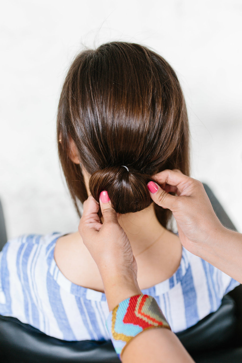 Securing the bun before braiding