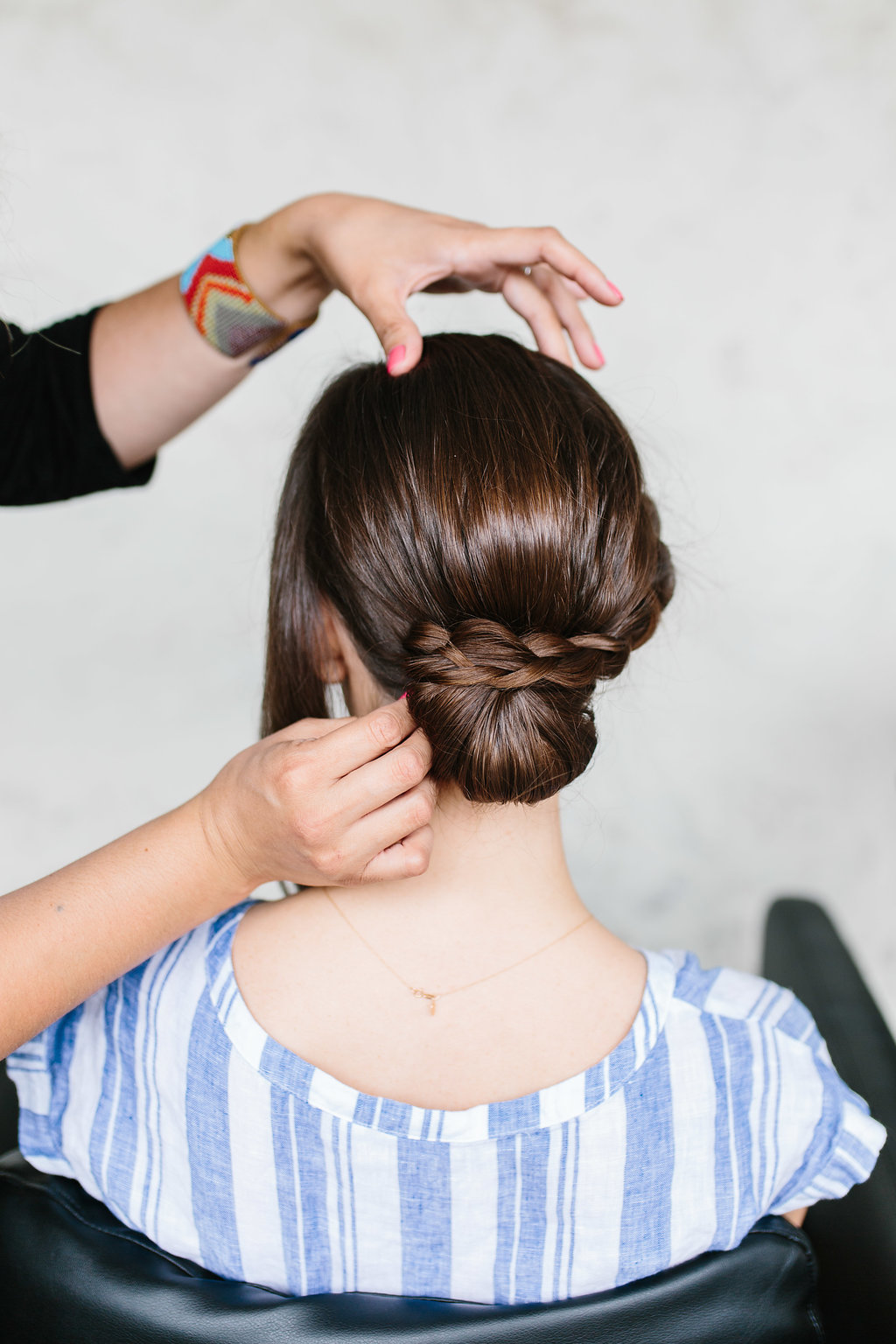 Securing a braid to the bun