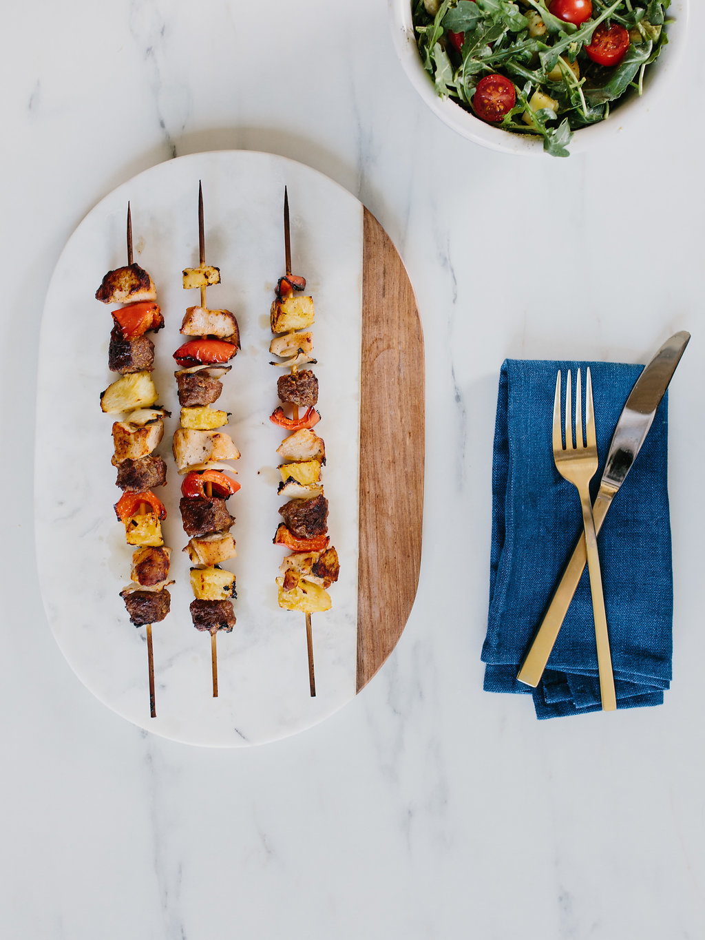 chicken pineapple kabobs on plate