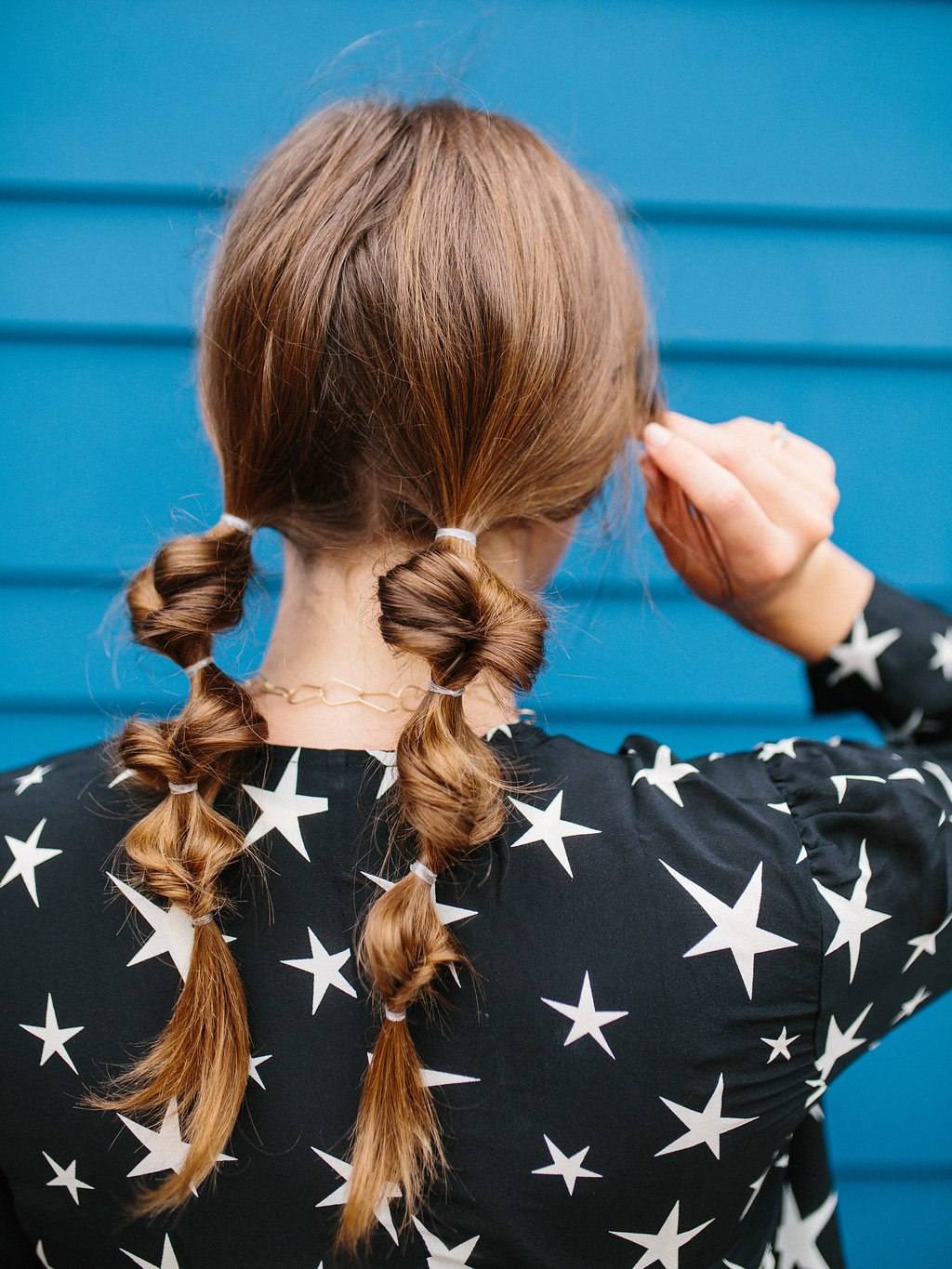 topsy tail pigtails on model