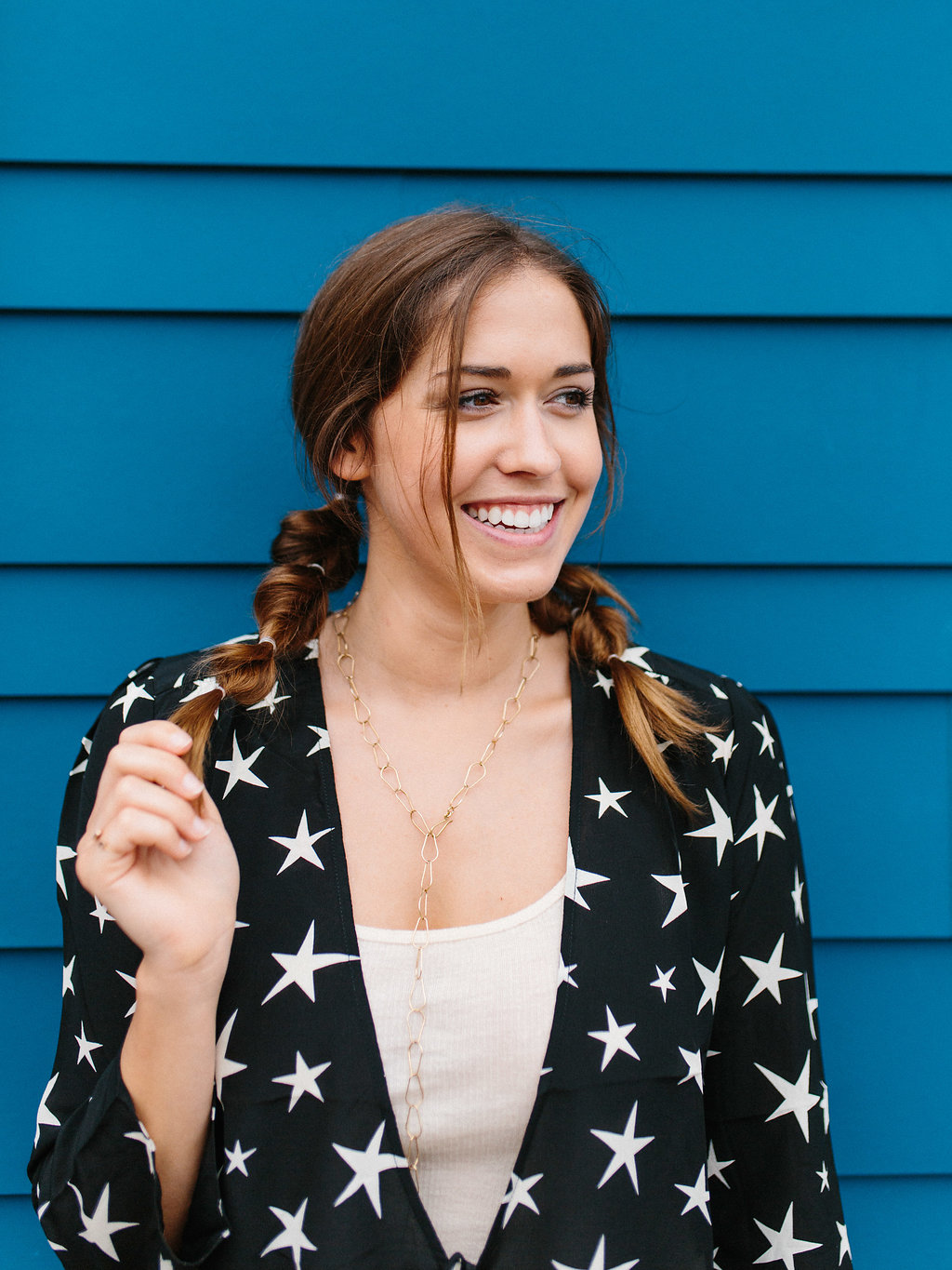 model smiling with pigtails