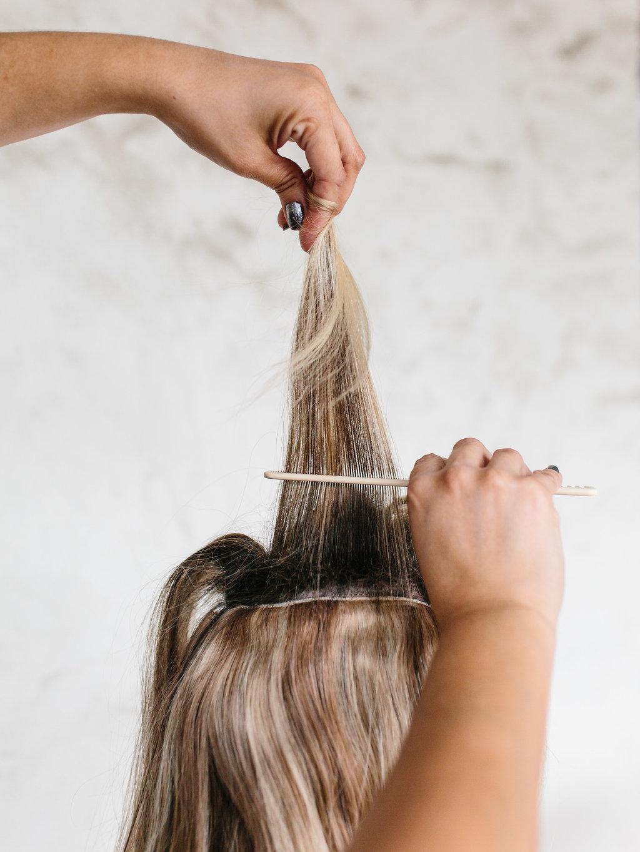 combing through hair