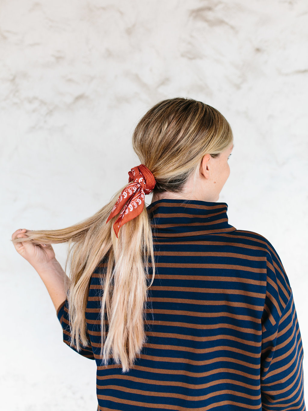 model with ponytail hair scarf style