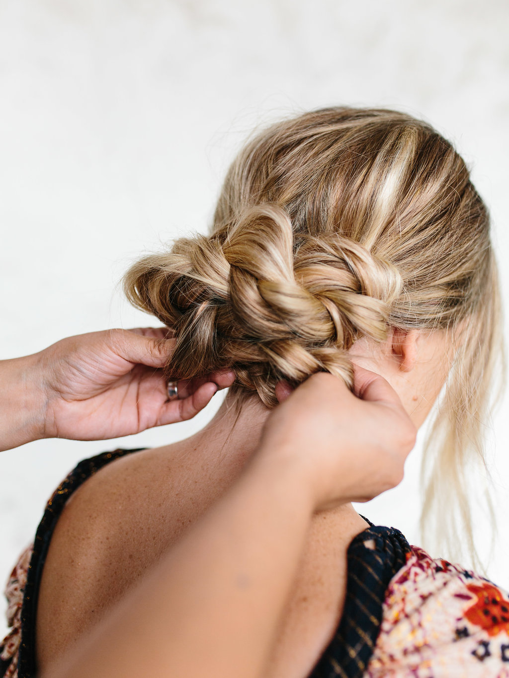 Last minute styling to the braided updo
