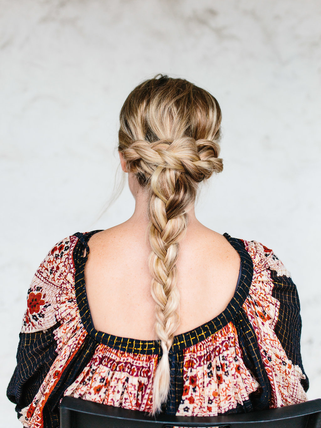 Two braids wrapped around with one loose