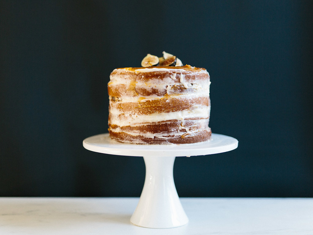 An iced cake on a cake stand ready to serve