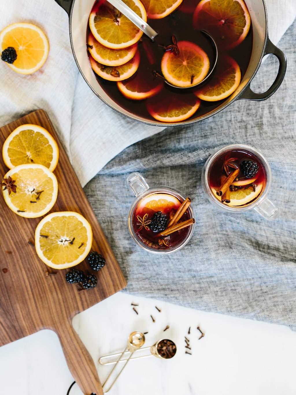 Two glasses of citrus mulled wine with orange slices