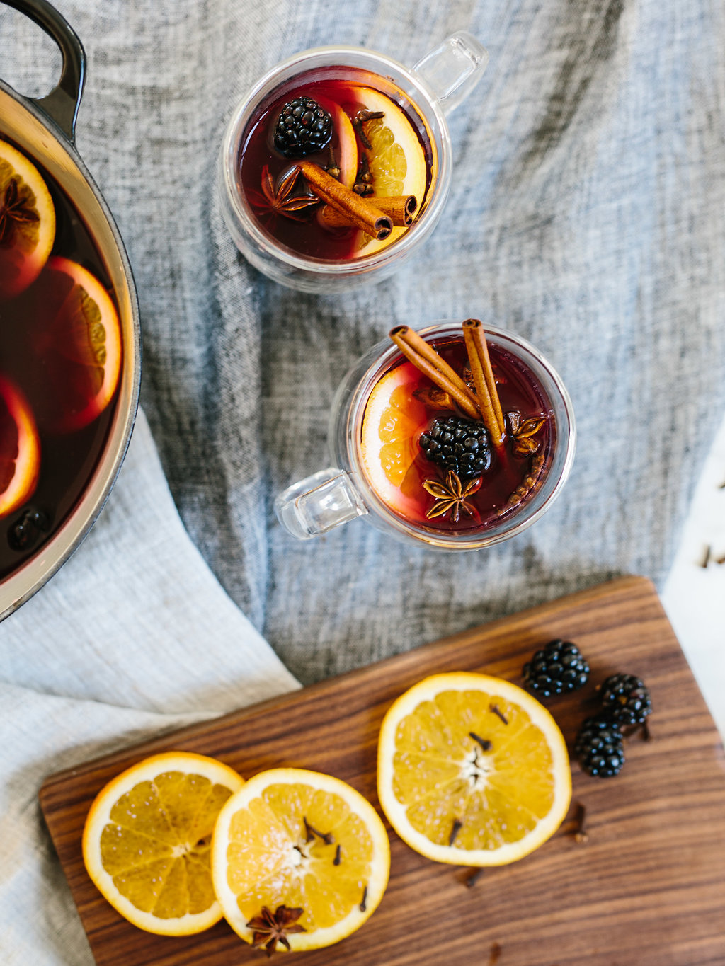Citrus mulled wine in two glass mugs