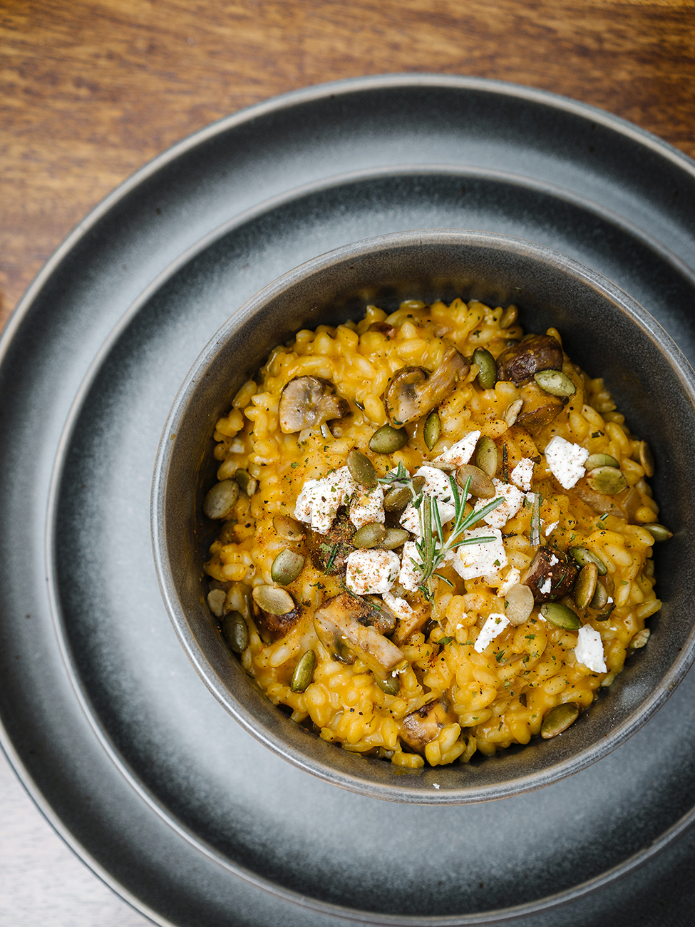 Pumpkin risotto served in a black bowl
