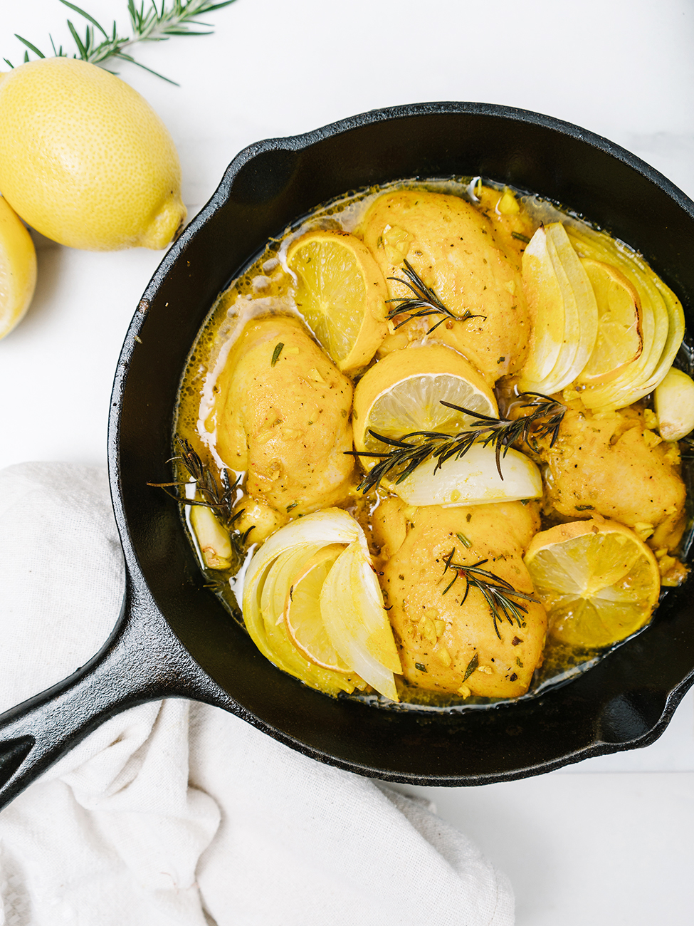 Lemon garlic chicken in a skillet