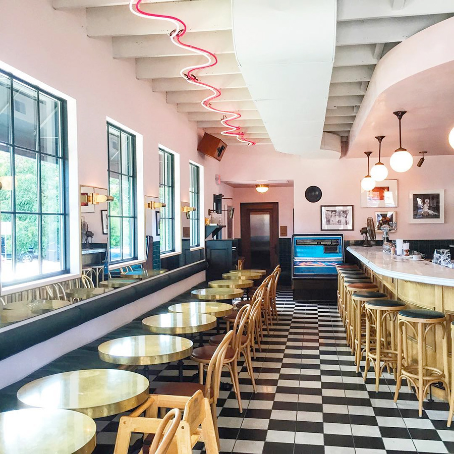Pink, white and black restaurant interior