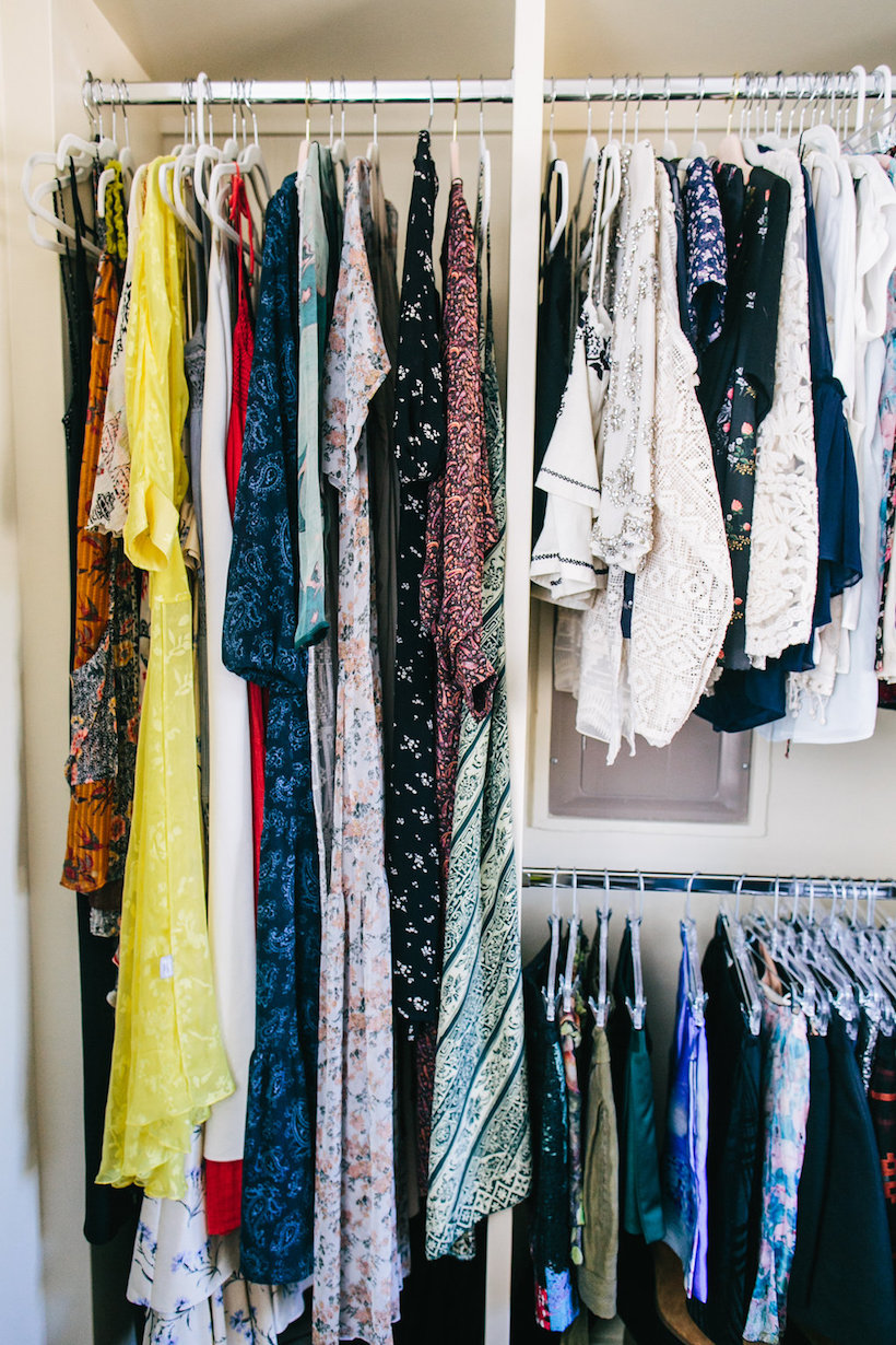 Tops and dresses hanging in a wardrobe