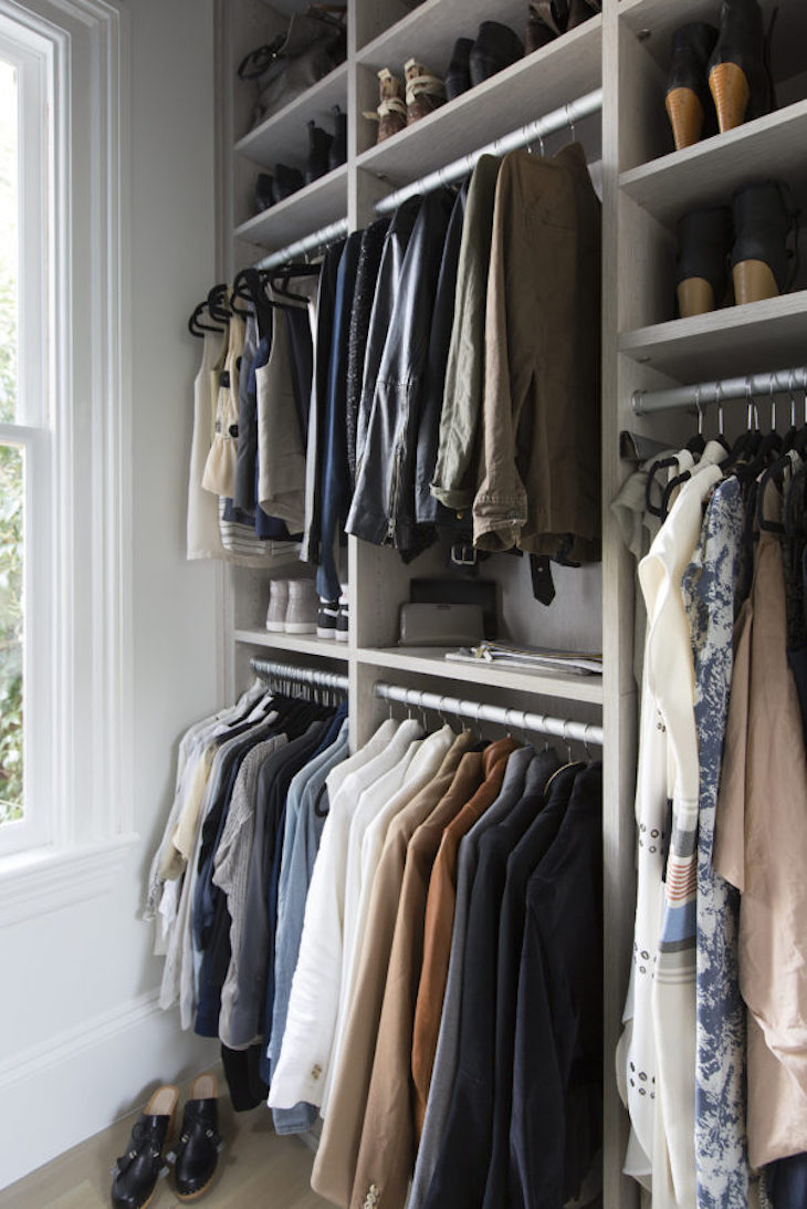 Clothes hanging in a wardrobe