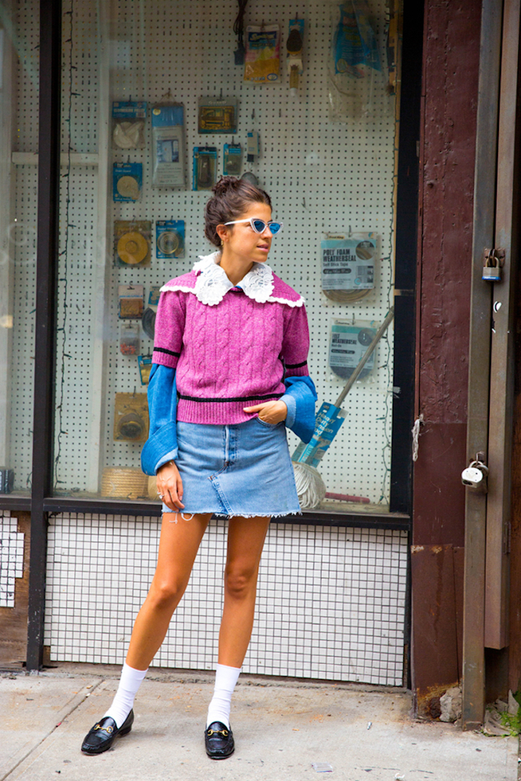 model wearing a skirt with pink jumper