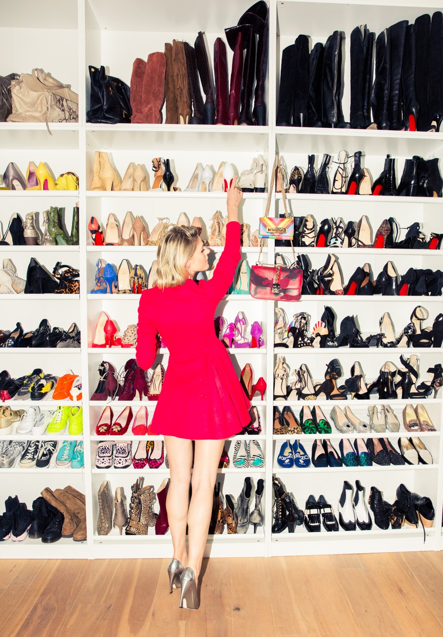 A model in front of a rack of shoes