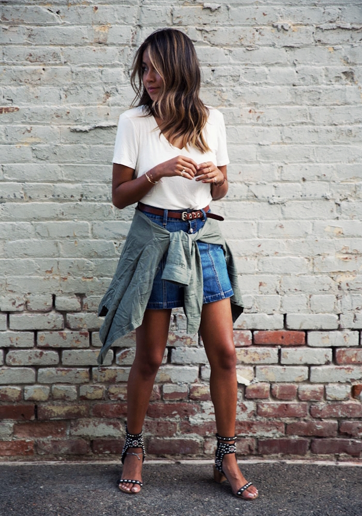 Model in denim skirt with a jumper tied around the waist
