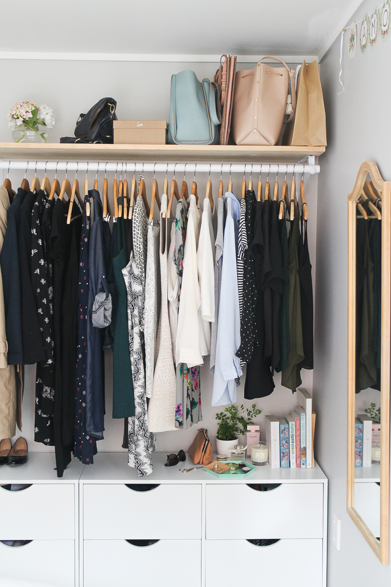 Clothes hanging in an organised wardrobe