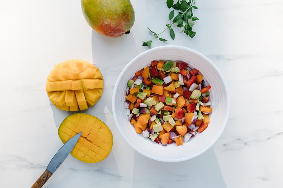 Mango salsa in a white bowl to accompany cedar plank salmon