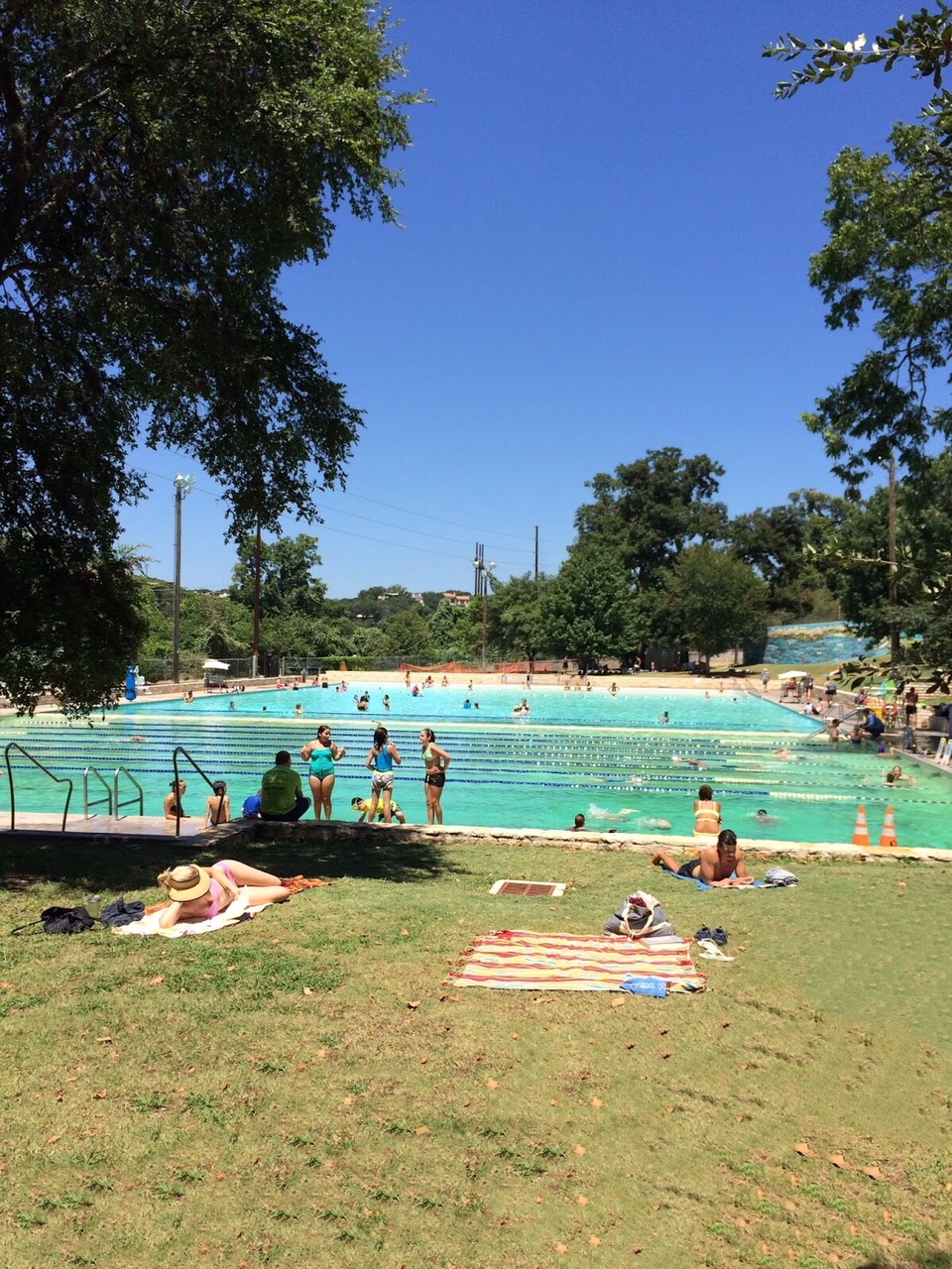 An outdoor pool in austin with kids